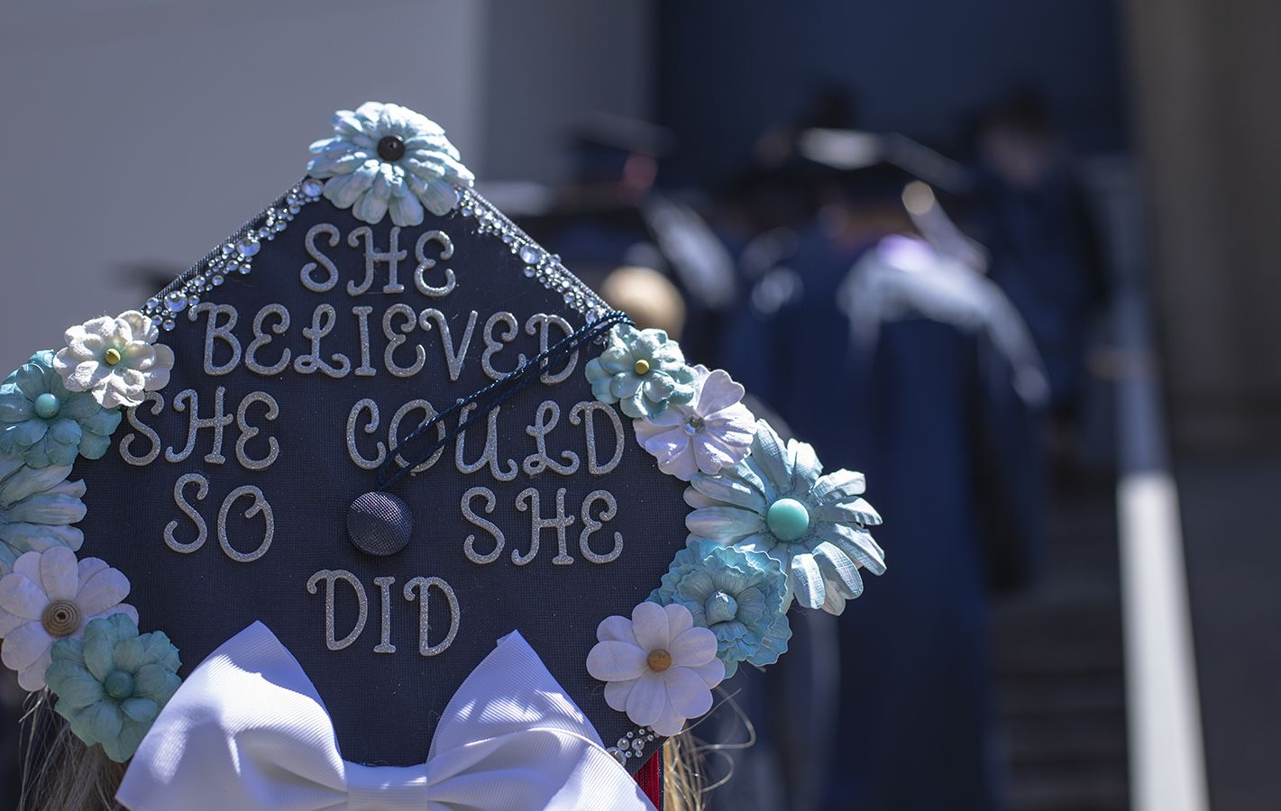 graduation cap decorated with lettering and flowers