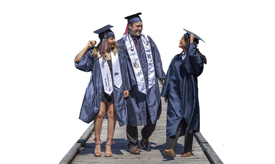 Three SWOCC student graduates walk on dock