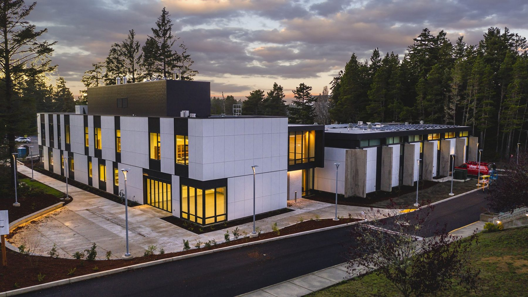 Photo of Umpqua Hall in the evening with sunset