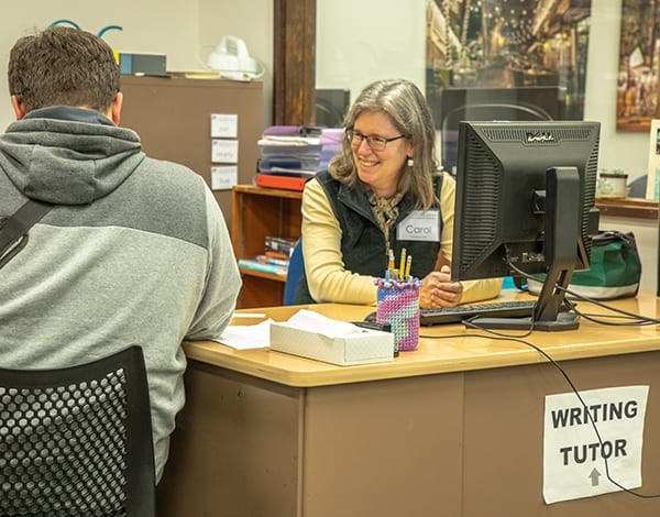 Student receiving help in the writing center
