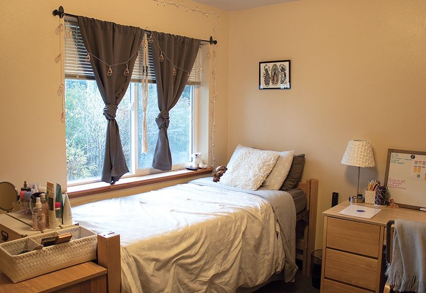 Bedroom with a desk in a student housing apartment