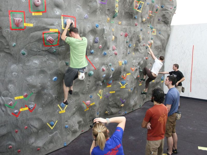 Students learning how to rock climb in the Student Recreation Center