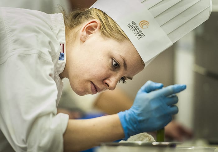 Culinary student decorating a pastry